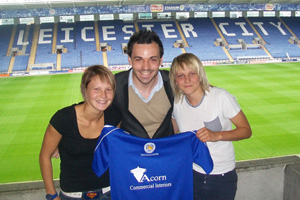 Leicester City Ladies first team manager Matt Cook with new signings Kayleigh Hillier and Kate Bateman