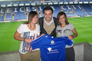 Leicester City Ladies first team manager Matt Cook with new signings Kyleigh Brant and Rebecca Preston